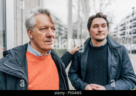 Senior man and young man in the city - Stock Photo