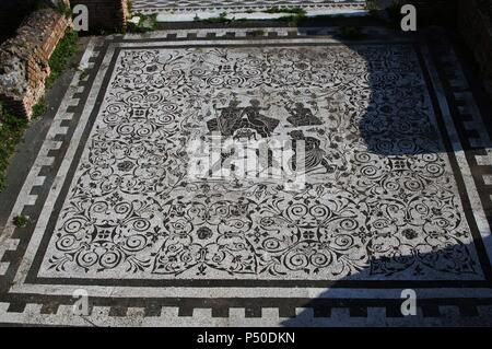 Roman Art. Italy. House of Bacchus and Ariadne. Floor mosaic in black and white. It depicts Bacchus with his wife Ariadne and the struggle of Eros and Pan (love and lust) with an old Silenus as referee. 1st-2nd centuries A.C. Ostia Antica. - Stock Photo