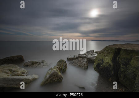 a beautiful and atmospheric isle of wight seascape or sunset over the sea at compton bay near freshwater bay.. - Stock Photo