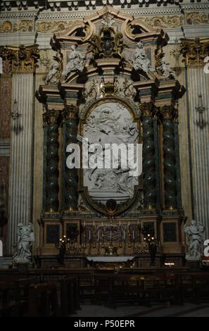 Italy. Rome. The Church of St. Ignatius of Loyola at Campus Martius. Side chapels. Transept: Chapel of the Annunciation, 1749. Marble altarpiece depicting the Annunciation by Filippo Della Valle (1698-1768) with allegorical figures and angels by Pietro Bracci (1700-1773). - Stock Photo