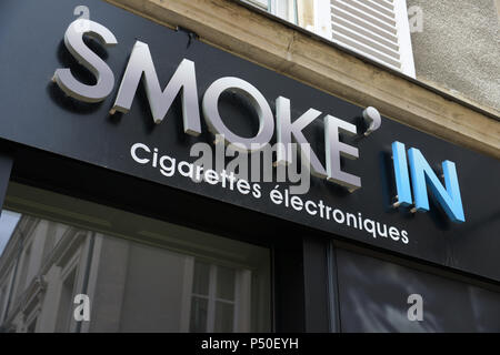 Smoke in the electronic cigarette shop in the centre of Le Mans - Stock Photo