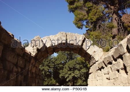 Greek Art. Sanctuary of Olympia. Entrance to olympic stadium. Stone arch. III B.C. The east of archaelogical site.  Elis. Peloponesse. Greece. Europe. - Stock Photo