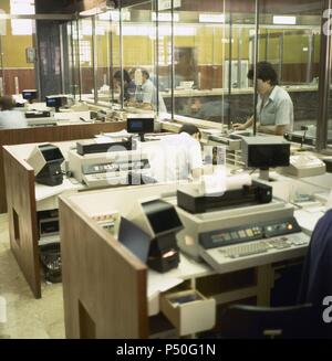 Spain. Years 80's. Spanish Banking. Office of a bank. Teleprocessing (1981). Mallorca. Balearic Islands. - Stock Photo