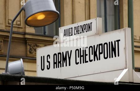 Checkpoint Charlie. The most famous of the crossing points of the Berlin Wall between the two parts of the city. Berlin. Germany. - Stock Photo