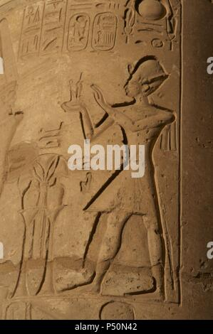 Ramesseum. Relief depicting the pharaoh making an offering to the gods. 13th century B.C. Nineteenth Dynasty. New Kingdom. Necropolis of Thebes. Valley of the Kings. Egypt. - Stock Photo