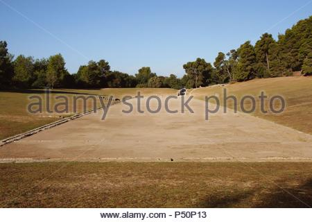 Greek Art. Sanctuary of Olympia. Panorama of the ancient Olympic Stadium. The east of archaelogical site.  Elis. Peloponesse. Greece. Europe. - Stock Photo