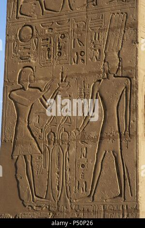 Relief depicting a Pharaoh making offerings to the god Onuris-Shu. Ramesseum. 13th century. Nineteen dynasty. New Kingdom. Necropolis of Thebes. Valley of the kings. Egypt. - Stock Photo