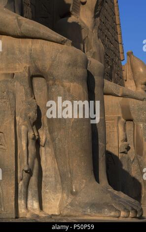 Ramesses II. Detail of his leg. New Kingdom. Temple of Luxor.  Egypt. - Stock Photo
