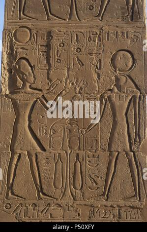 Relief depicting a Pharaoh making offerings to the god Ra. Ramesseum. 13th century. Nineteen dynasty. New Kingdom. Necropolis of Thebes. Valley of the kings. Egypt. - Stock Photo