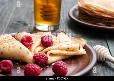 Pancakes with honey and fruit - Stock Photo