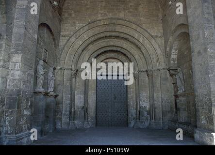 Saint Peter's Cathedral. Romanesque temple built during the kingdom of Ramiro I (1035-1063), king of Aragon. XI century. Main gate or Saint Peter's portico with a monogram of Christ in the tympanum. Jaca. Aragon.  Spain. - Stock Photo