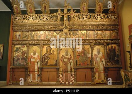 Wooden iconostasis of the church of St. Demetrius of Kola. Dated 1690. At the bottom are represented: St. Demetrius, Pope Clement, Virgin Hodegetria, Pope Sylvester, enthroned Christ, Pope Leo and St. John the Baptist. Byzantine Museum. Zante. Ionian Islands. Greece. - Stock Photo