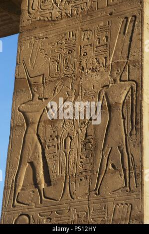 Relief depicting a Pharaoh making offerings to the god Amun. Ramesseum. 13th century. Nineteen dynasty. New Kingdom. Necropolis of Thebes. Valley of the kings. Egypt. - Stock Photo