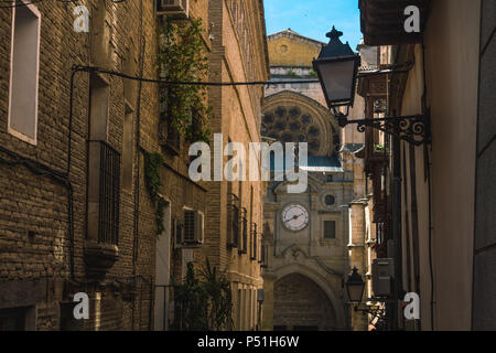 Picturesque Alley Of old Houses in the City of Toledo, Spain. Leadint to side entrance of the wonderful cathedral of Toledo. Summer Evening Scene - Stock Photo