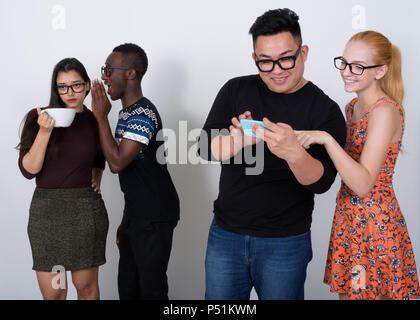 Happy diverse group of multi ethnic friends smiling and wearing  - Stock Photo