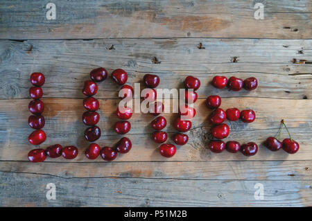 Love word made from cherries. Love concept. - Stock Photo