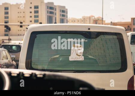 Doha, Qatar - Mart, 2018: Portrait of Qatari Emir - Tamim bin Hamad Al Thani on the back car window. - Stock Photo