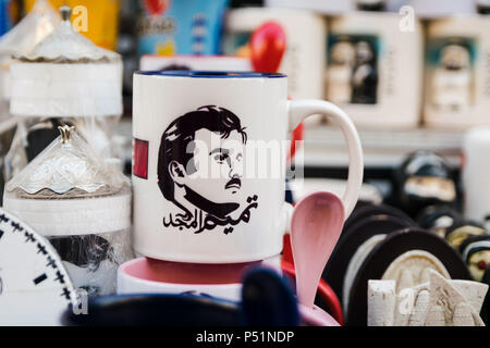 Doha, Qatar - Mart, 2018: Portrait of Qatari Emir - Tamim bin Hamad Al Thani on whirte souvenir cup.  Souq Waqif street. - Stock Photo