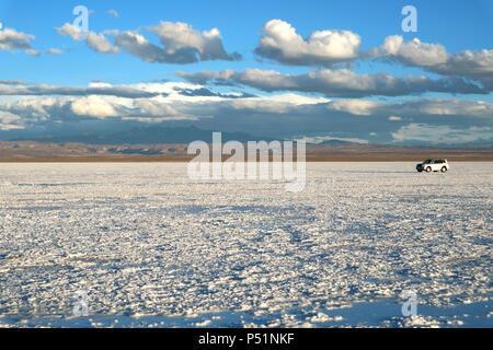 Driving on Salar de Uyuni or Uyuni Salts Flats, Bolivia, South America, UNESCO World Heritage - Stock Photo