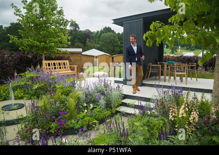 Nick Bailey in garden by seating area & border plants - CCLA : A Family Garden, RHS Chatsworth Flower Show, Chatsworth House, Derbyshire, England, UK. - Stock Photo