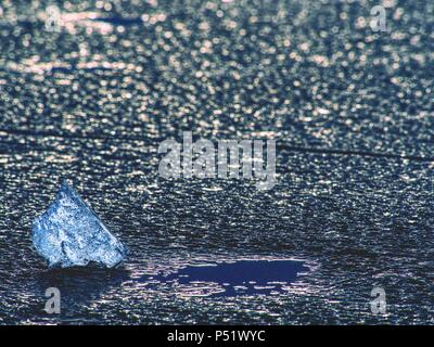 Climate Change. Icy floes mealtiing on beach. Tourist attraction disappearing Glaciers. Ice on the black volcanic sand. - Stock Photo