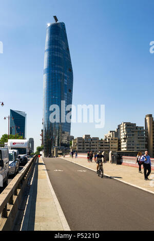 One Blackfriars building dominating the skyline above Blackfriars bridge with people, cyclists and road traffic in foreground, London, UK - Stock Photo