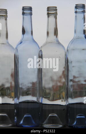 Row of old empty wine bottles on a window sill distorting the sun light, Englnd, UK, PETER GRANT - Stock Photo