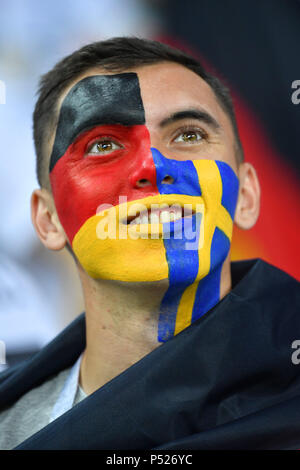 Sochi, Russia. 23rd June, 2018. male fan, football fan, boy with the flags of Germany and Sweden as face painting male, portrait, portrait, portrait. Germany (GER) -Sweden (SWE) 2-1, Preliminary Round, Group F, Match 27, on 23.06.2018 in SOCHI, Fisht Olymipic Stadium. Football World Cup 2018 in Russia from 14.06. - 15.07.2018. | usage worldwide Credit: dpa/Alamy Live News Credit: dpa picture alliance/Alamy Live News - Stock Photo