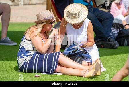 Eastbourne UK 24th June 2018  - Tennis fans enjoy hot sunny weather at the Nature valley International tennis tournament being held in Devonshire Park eastbourne . The weather is forecast to become hotter over the next week throughout Britain Credit: Simon Dack/Alamy Live News - Stock Photo
