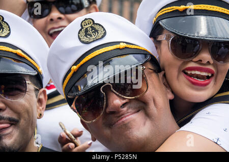 Mexico City, Mexico. 23rd June, 2018. People participate in the Mexican Gay Pride Parade. Soccer fans and the Gay Pride Parade celebrated together after Mexico's second victory in the FIFA World Cup 2018. Credit: Jesús Alvarado/dpa/Alamy Live News - Stock Photo