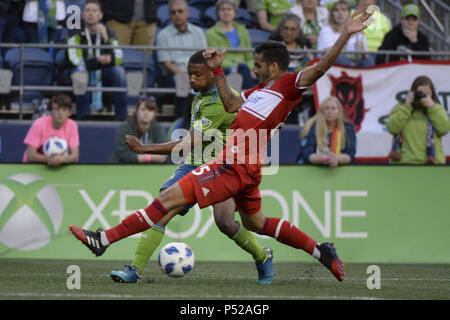 Seattle, Washington, USA. 23rd June, 2018. Chicago's JORGE CORRALES (25) defends against Seattle's JORDAN MCCRARY (30) as the Chicago Fire visits the Seattle Sounders in a MLS match at Century Link Field in Seattle, WA. Credit: Jeff Halstead/ZUMA Wire/Alamy Live News - Stock Photo