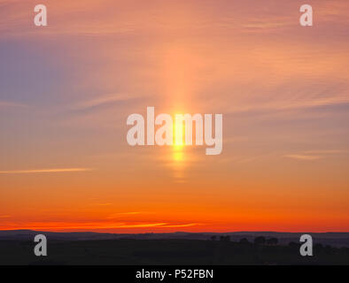 Brassington, Derbyshire, UK. 24th June, 2018. Weather UK: sun pillar solar column during an amazing sunset at Harborough Rocks near Brassington & the High Peak Trail, Derbyshire, Peak District National Park Credit: Doug Blane/Alamy Live News - Stock Photo
