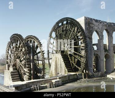 Syrian. The Norias of Bechriyyat in Hama. The waterwheels at Hama, known as Norias, are up to 20m high and have been standing since the 13th century. Middle East. - Stock Photo