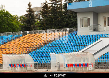 Empty bright seats in stadium and for sport teams - Stock Photo