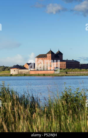 Beautiful view of the 13th century Häme Castle and lake Vanajavesi in Hämeenlinna, Finland, on a sunny day in the summer. Copy space. - Stock Photo