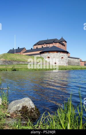 Beautiful view of the 13th century Häme Castle and lake Vanajavesi in Hämeenlinna, Finland, on a sunny day in the summer. - Stock Photo
