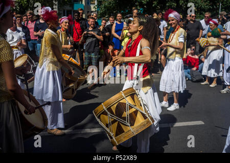 The street parade is the highlight of Carnival of Cultures during Pentecost weekend in Berlin. - Stock Photo
