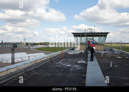 Berlin, Germany - View from the roof of the Kopfbaus West where a visitor's path is to be created. In the background the former tower of the airport Berlin Tempelhof and the Tempelhofer field. - Stock Photo