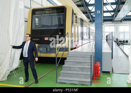 Berlin, Germany - Peter Buchner, chairman of the management of the Berlin S-Bahn in front of the model on a scale of 1: 1 of the new S-Bahn class 483 - Stock Photo