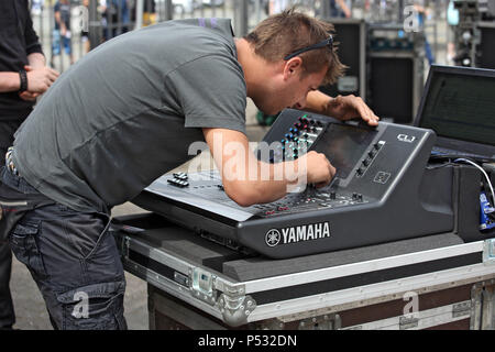 Hannover, Lower Saxony, Germany, sound engineer working on a mixing console - Stock Photo