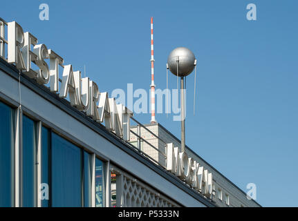 Detail of the Cafe Moskau with TV tower and a DDR-Plattenbau in the Karl-Marx-Allee - Stock Photo