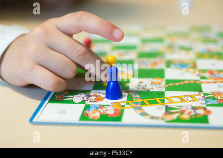 Children at the board game - Stock Photo