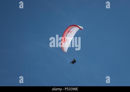 Paragliding in Lauterbrunnen Switzerland - Stock Photo