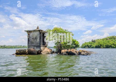 Sthapaheduwa, a small island in the Madu River with a Hindu shrine, Maduganga Lake, Madu Ganga wetlands, south-west Sri Lanka - Stock Photo