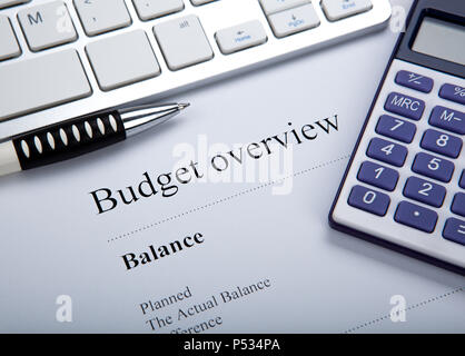 document with title budget overview and keyboard, calculator close up - Stock Photo