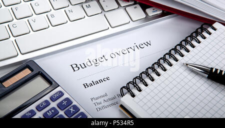 document with title budget overview and office tools close up - Stock Photo