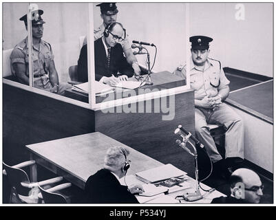 1961 Defendant Adolf Eichmann German Nazi War Criminal takes notes during his trial in Jerusalem. He was in charge of transporting millions of European Jews to death camps.The glass booth in which Eichmann sat was erected to protect him from assassination. He was found guilty convicted and the death sentence was passed and duly carried out - Stock Photo