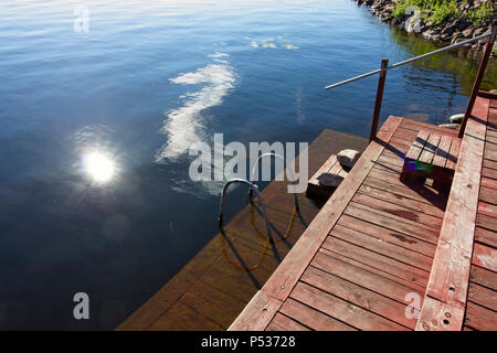 handrails and ladders on wooden jetty - Stock Photo