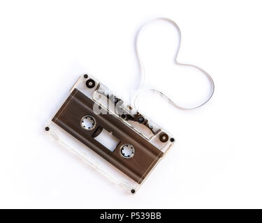 Translucent audio cassette with the magnetic tape in the shape of a heart  isolated on white background, music love concept - Stock Photo