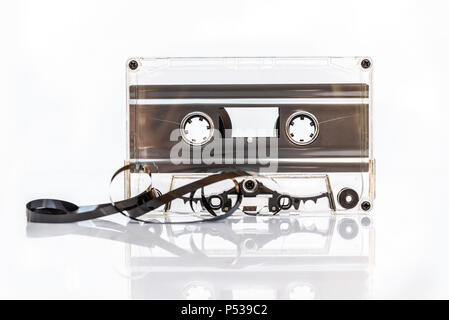 Translucent audio cassette tape isolated on white background - Stock Photo